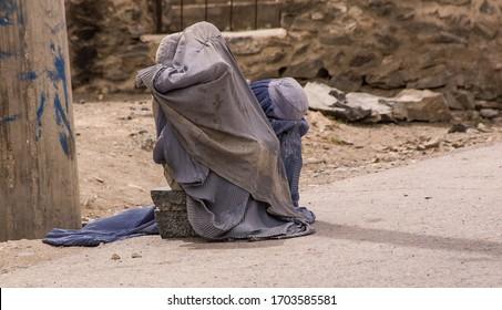 Kabul, Afghanistan April 2004: women in burqas on Kabul roadside