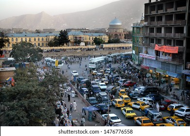 Kabul / Afghanistan - Aug 16 2005: A view of central Kabul, Afghanistan showing the market, traffic, crowds of people and distant hills. Kabul Market, people, mosque, hills, central Kabul, Afghanistan