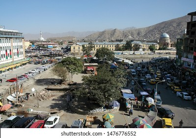 Kabul / Afghanistan - Aug 17 2005: A view of central Kabul, Afghanistan showing the market, traffic, crowds of people and distant hills. Kabul Market, people, mosque, hills, central Kabul, Afghanistan
