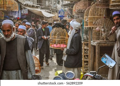 Kabul, Afghanistan - circa October 2011: Photo of marketplace full of shopping people in Old town, old city part in Kabul. In this market people can buy and sell birds in cages. Documentary editorial.