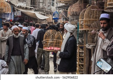 Kabul, Afghanistan - circa October 2011: Photo of marketplace full of shopping people in Old town, old city part in Kabul. In this part of market people buy birds in cages. Documentary editorial.
