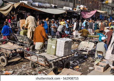 Kabul, Afghanistan - circa October 2011: Many people do shopping at marketplace in Old town, old city part in Kabul. Documentary editorial.