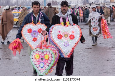 Kabul, Afghanistan, Feb 2005: Men selling flowers for to give to those returning from the Haj