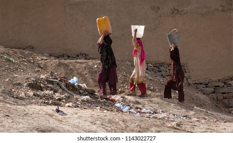 Kabul, Afghanistan, Mar 2004: Women carrying water in Kabul, Afghanistan