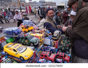 Kabul, Afghanistan, March 2005: Chosing toys at a Kabul street market stall