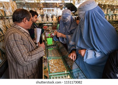 Kabul, Afghanistan, March 2005: Woman looking at jewelry in Kabul jewellers