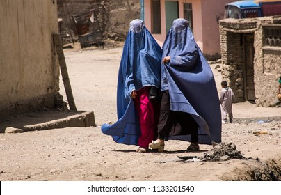 Kabul, Afghanistan, May 2004: Afghan women in burqas walking in the street in Kabul