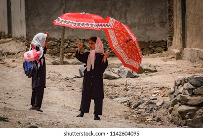 Kabul, Afghanistan - May 2004: Girls returning from school in Kabul