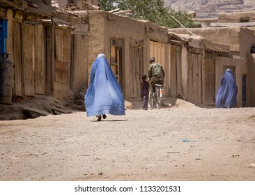 Kabul, Afghanistan May 2004: Women in burqas in Kabul street, Afghanistan