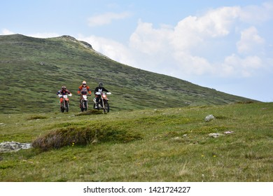 Kabul, Rila Mountain, Bulgaria - June 9, 2019: Three young men off-road motor-bikers riding endure motorcycles high on the slopes of Kabul Peak