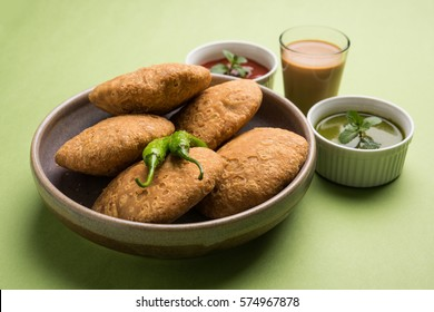 Kachori is a Flat spicy snack from India also spelled as kachauri and kachodi. Served with tomato ketchup. Selective focus