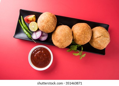 Kachori is a spicy snack from India also spelled as kachauri and kachodi. Served with tomato ketchup. Favourite Tea time snacks Selective focus