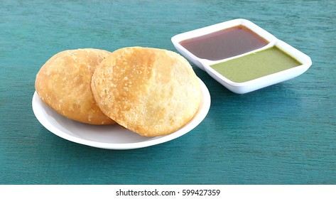Kachori, a vegetarian food, native to the state of Rajasthan, India, and green and tamarind chutneys.