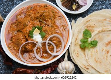 Kadai Chicken/Karahi curry/tikka masala/Korma with paratha/Kerala protta, hot and spicy gravy dish Pakistan, North India. Non-vegetarian food prepare using Indian spices/masala. Side dish chapati/roti