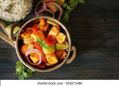 Kadai Paneer served with Jeera rice / Indian Vegetarian meal top down view with copy space