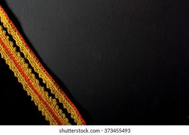 Kadazan Penampang costume design. Handmade crochet gold & red yarn. for background. Harvest festival Kaamatan celebration theme. Copy space