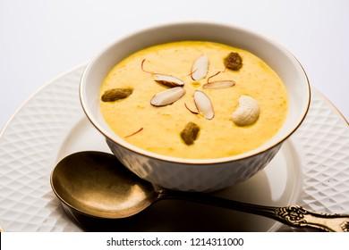 Kaddu or Pumpkin Kheer Or Bhoplyachi Kheer in Marathi and gummadikaya payasam in Telugu, Garnished with dry fruits. served in a bowl over moody background. Selective focus