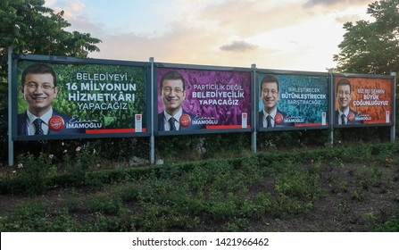 Kadikoy,Istanbul/Turkey-June,12,2019: Ekrem İmamoglu, the candidate for the Mayor of Istanbul Metropolitan Municipality. The picture of him is on the billboards. Sunset with cloudy sky is background.