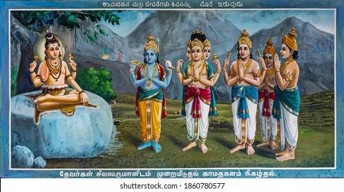 Kadirampura, Karnataka, India - November 4, 2013: Sri Murugan Temple. Colorful painting on which other Hindu gods plead with Lord Shiva to name general to defeat demon Surapadman.