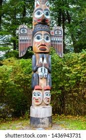 Kadjuk Bird Totem Pole at Totem Bight State Historical Park, Ketchikan, Alaska. Native American tradition. Totem animals act as guardian spirits.