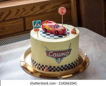 "Kadubivtsi Chernivtsi Ukraine 24.06.2018 . Cake with a car model from the cartoon ""Lightning Mcqeen"". On the cake is written the name of the birthday man ""Sashko"""