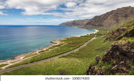 Kaena Point Beach scenic seascape and road seen from the ridge on the west side of Oahu, Hawaii, USA.