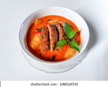 KAENG PHED PED YANG. Roasted Duck with pineapple,sweet basil leaves and chili peppers in red curry, Thai style.