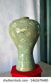 Kaesong, North Korea - May 4, 2019: Confucian educational facility of the Koryo dynasty. Broad-shouldered celadon vase adorned with drawings of the red cranes. 12th-century