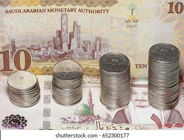 KAFD with coins on medina, showing religious tourism and financial investment in saudi arabia