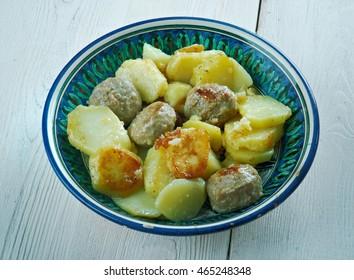 Kafta and Potatoes with Tahini Sauce - Mediterranean Meatballs .Palestinian style Kafta dish