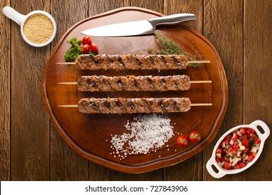 Kafta steak skewers on top of a board