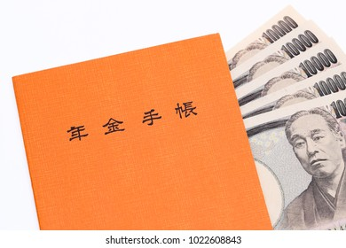 KAGAWA, JAPAN - JANUARY 22: Japanese national pension plan handbook and money on white background