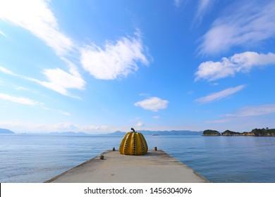 Kagawa Japan September 09 2016: Yayoi Kusama's giant pumpkin sculpture in front of the sea. in Naoshima Art island,