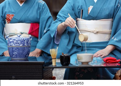 KAGAWA, JAPAN - SEPTEMBER 20, 2015: Japanese women in traditional kimono prepares the tea ceremony at garden of the Hagiwara Temple on September 20, 2015 in Kagawa Japan.