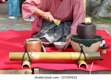 KAGAWA, JAPAN - SEPTEMBER 23, 2013: Japanese man in traditional kimono prepares the tea ceremony at garden of the Hagiwara Temple on September 23, 2013 in Kagawa Japan.