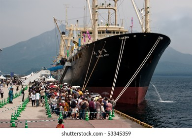 KAGOSHIMA CITY, JAPAN - APRIL 27:    People wait in line to board the whaling factory ship Nisshin Maru, berthed at a whaling festival April 27, 2008 in Kagoshima City, Japan.
