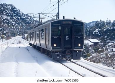 KAGOSHIMA CITY, JAPAN - JANUARY 1: Japan Rail train pulling into Matsumoto Station, January 1, 2011 in Kagoshima City. A rare heavy snowfall December 30, 2010 disrupted trains for days.