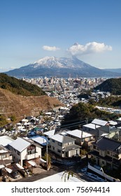 KAGOSHIMA CITY, JAPAN - JANUARY 2: Volcano Sakurajima erupting  after a recent snow.  This  rare snowstorm closed roads and stopped trains for two days, Kagoshima City, Japan, January 2, 2011.