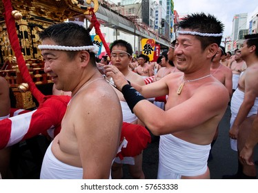 KAGOSHIMA CITY, JAPAN - JULY 19: Japanese man applying ice to the shoulders of a participant  at the Ogion festival July 19, 2009, in Kagoshima City, Japan.