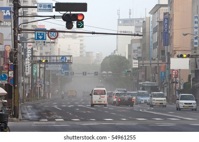KAGOSHIMA CITY, JAPAN - JUNE 3: Traffic is affected as ash blankets the city after an  eruption of the  volcano Sakurajima   June 3, 2010 in Kagoshima City, Japan.