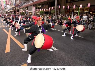 KAGOSHIMA CITY, JAPAN - NOVEMBER 3:  Okinawan style taiko drummers perform during the Ohara Matsuri dance festival November 3, 2005 in Kagoshima City, Japan. Over 10,000 dancers participate yearly.