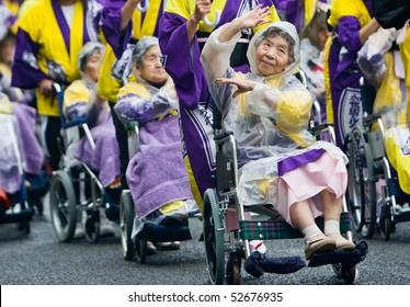 KAGOSHIMA CITY, JAPAN - NOVEMBER 3: Elderly Japanese Festival Dancers in wheelchairs at the Ohara Matsuri dance festival November 3, 2008 in Kagoshima City, Japan.