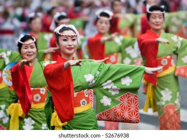 KAGOSHIMA CITY, JAPAN - NOVEMBER 3:  Women in kimono dancing in a symmetrical line during the Ohara Matsuri dance festival November 3, 2008 in Kagoshima City, Japan.