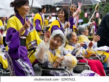 KAGOSHIMA CITY, JAPAN - NOVEMBER 3: Elderly Japanese Festival Dancers in wheelchairs at the Ohara Matsuri dance festival November 3, 2008 in Kagoshima, Japan.