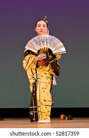 KAGOSHIMA CITY, JAPAN - OCTOBER 27: Japanese dancer in kimono performs onstage in the night portion of the Taniyama Furusato Matsuri festival October 27, 2007 in Kagoshima City, Japan.
