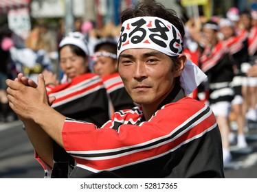 KAGOSHIMA CITY, JAPAN - OCTOBER 28:  A Man in a black and red  hakama  leads a dancing line  during the Taniyama Furusato Matsuri dance festival October 28, 2007 in Kagoshima City, Japan..