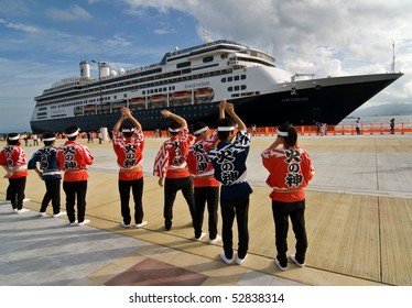KAGOSHIMA CITY, JAPAN - OCTOBER 8:  Taiko Drummers wave farewell to the first cruise ship to dock at the newly built marine port, the ms Amsterdam October 8, 2007 in Kagoshima City.