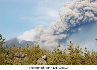 Kagoshima city, Japan.1 Dec 2013. Eruption of Sakurajima is one of the most active volcano in the world. Grainy.