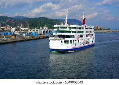 KAGOSHIMA, JAPAN -2 NOV 2017- View of the Sakurajima ferry, a boat crossing between the cherry blossom island, an active volcano, and Kagoshima in Kyushu, Japan.