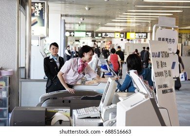 KAGOSHIMA, JAPAN - APRIL 24, 2010: Passenger showing boarding pass to company staff before boarding to airplane. It is codeshare flights operated by SKY Net Asia Airline and ANA (Kagoshima and Naha)